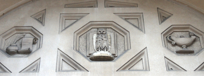 Details of Ascension School building symbolizing learning; above main entrance