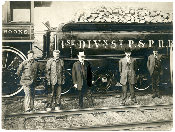 St. Paul & Pacific Railroad engine and tender with James J. Hill (center),